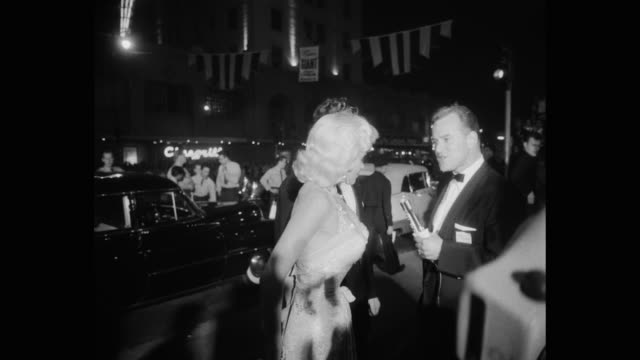 jayne mansfield and actor mickey hargitay giving interview at premiere of giant los angeles california united states of america - young men stock videos & royalty-free footage