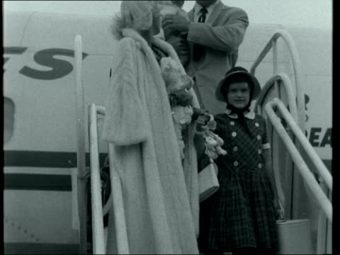 jayne mansfield arrives at lap with family ***also london lap jayne mansfield with husband mickey hargitay daughter and little son down plane steps... - mickey hargitay stock videos & royalty-free footage