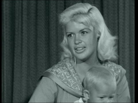 jayne mansfield arrives at lap with family ***also london lap int mickey hargitay holding up balancing child jayne mansfield interview sof - mickey hargitay stock videos & royalty-free footage
