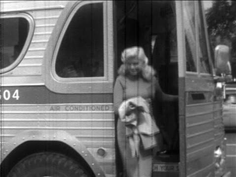 Jayne Mansfield exiting bus in promotional tour for 'Will Success Spoil Rock Hunter'