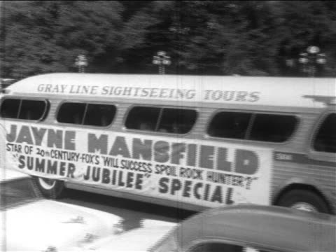 "jayne mansfield's bus passing cam in promotional tour for ""will success spoil rock hunter?"" - 1957 stock videos & royalty-free footage"