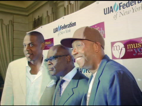 jay-z/ president and ceo, island def jam music, antonio 'reid/ chairman, island def jam music and russell simmons/ def jam music founder at the uja -... - russell simmons stock videos & royalty-free footage