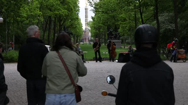 jazz band is playing in the tiergarten park in the evening as the victory column stands behind during the coronavirus pandemic on may 21, 2021 in... - vignette stock videos & royalty-free footage