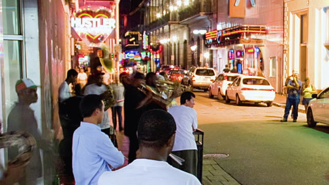 t/l ms jazz band playing on royal street with onlookers, new orleans, louisiana, usa - new orleans stock videos and b-roll footage