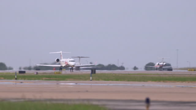 Jazz commuter jet (Bombardier CRJ)  lifts from runway - extreme telephoto/DFW International Airport, Dallas-Fort Worth, Texas, USA