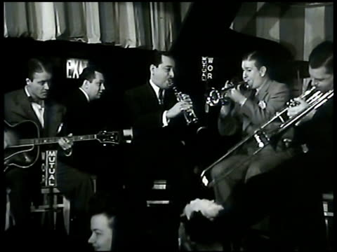 jazz drummer dave tough drumming on stage cigarette in mouth band playing jazz double bassist jack lesberg playing. jazz trombonist brad gowans... - jazz stock videos & royalty-free footage