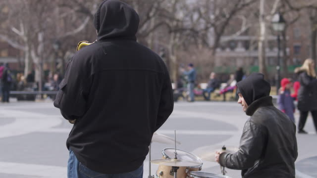 jazz duo performing in washington square park - street performer stock videos and b-roll footage