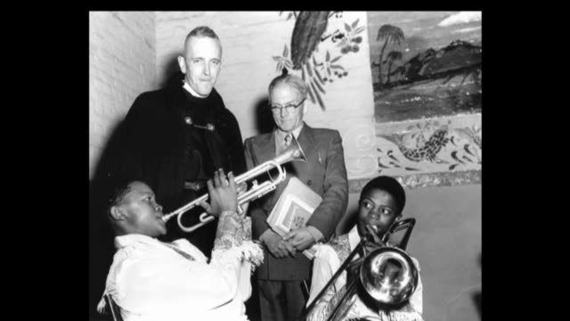 jazz musician hughie masekela dies aged 78 a young hugh masekela playing the trumpet as antiapartheid campaigner trevor huddleston and others look on - brass instrument stock videos & royalty-free footage