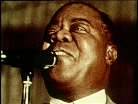 jazz musician louis armstrong sings hello dolly - jazz stock videos & royalty-free footage