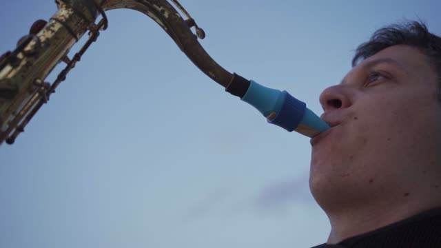 jazz musician performing on his saxophone with a big endurance - saxophone stock videos & royalty-free footage
