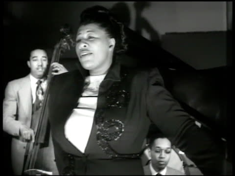 jazz vocalist ella fitzgerald aka 'first lady of song' singing w/ african-american jazz band bass fiddle drums piano. vs fitzgerald singing 'how high... - ella fitzgerald stock videos & royalty-free footage