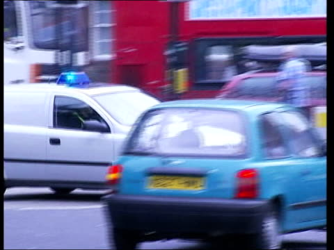 calls for inquiry/sir ian blair resignation tx england london stockwell ext police car along with siren on sot police officers at entrance to... - stockwell stock videos and b-roll footage