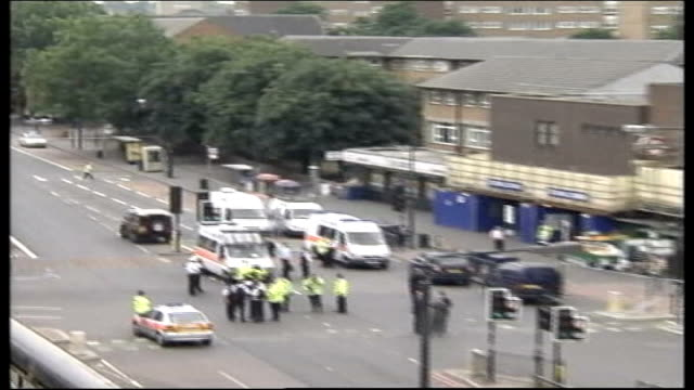 metropolitan police found guilty in health and safety trial tx stockwell underground station ext police outside tube station where police shot dead... - stockwell stock videos and b-roll footage