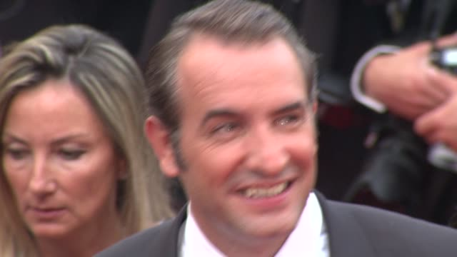 jean dujardin alexandra lamy at the closing gala awards red carpet 64th cannes film festival at cannes - jean dujardin stock videos and b-roll footage