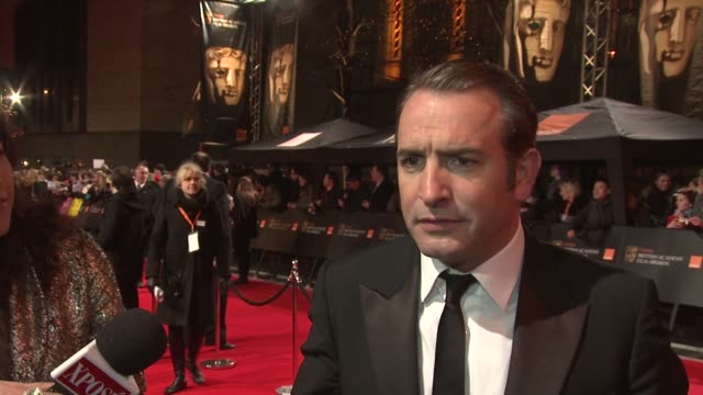 jean dujardin on being surprised at being nominated on being a star on uggie on how his life has changed at the royal opera house on february 12 2012... - jean dujardin stock videos and b-roll footage