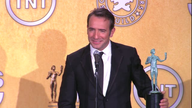 jean dujardin on the event on his sag award win for male actor in a leading role and on the dog from the artist at 18th annual screen actors guild... - jean dujardin stock videos and b-roll footage