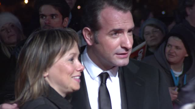 jean dujardin posing for pictures at 32nd london critics' circle film awards 2012 red carpet arrivals at bfi southbank on january 19 2012 in london... - jean dujardin stock videos and b-roll footage