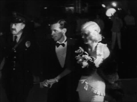 jean harlow date in formalwear walking past crowd outdoors at premiere / documentary - 1932 stock videos and b-roll footage