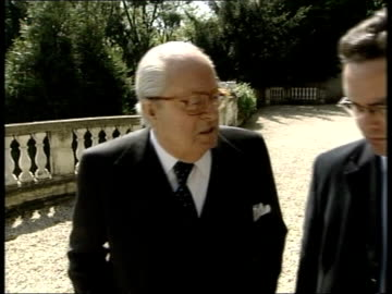 jean marie le pen interviewed sot - yes, more, it depends on good will of britons le pen along seen from bottom of steps side cms le pen chatting to... - population explosion stock videos & royalty-free footage
