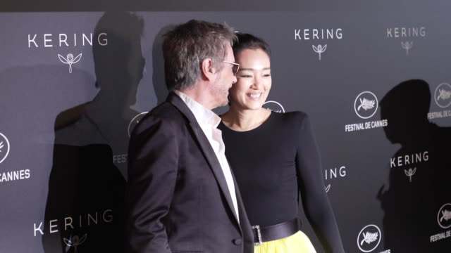 Jean Michel Jarre and Gong Li at Kering Women in Motion Party The 72nd Cannes Film Festival on May 19 2019 in Cannes France