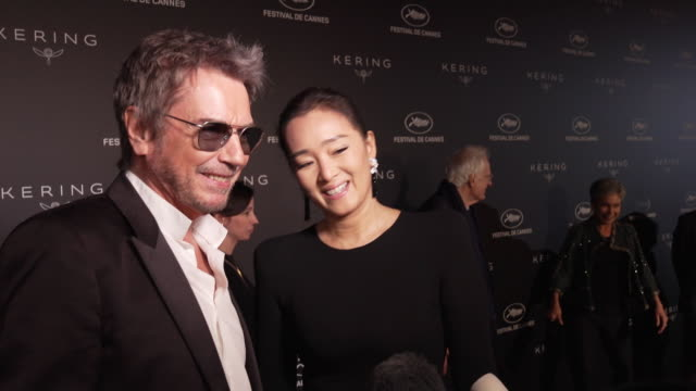 INTERVIEW Jean Michel Jarre and Gong Li refusing to confirm or deny rumours that they have recently married at Kering Women in Motion Party The 72nd...