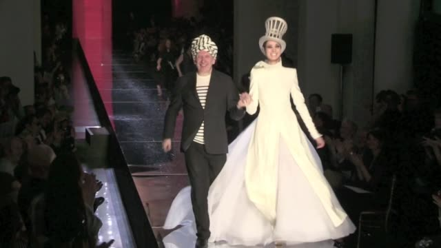 jean paul gaultier on the runway of the haute couture fashion show running after the model wearing the wedding dress jean paul gaultier on the runway... - fashion show stock videos & royalty-free footage