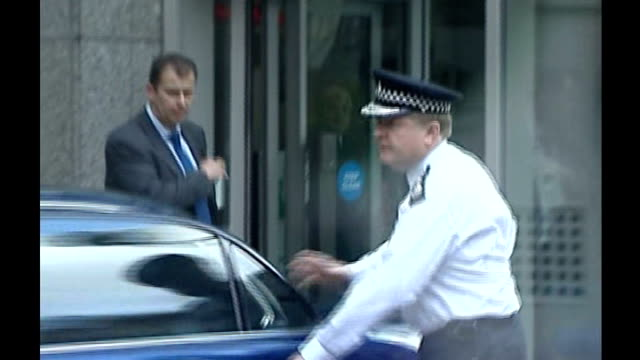 Day One Sir Ian Blair into car and away July 2005 Stockwell Tube Station Police and forensic officers outside Stockwell tube in aftermath of Menezes...