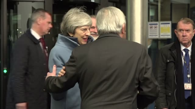 jeanclaude juncker and michel barnier greet theresa may warmly as she arrives at the eu in strasbourg - smiling stock videos & royalty-free footage