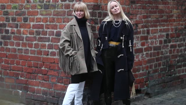 vídeos de stock e filmes b-roll de jeanette friis madsen wearing checked jacket with fringes turtleneck and thora valdimars wearing navy coat bag with fringes is seen outside... - copenhaga