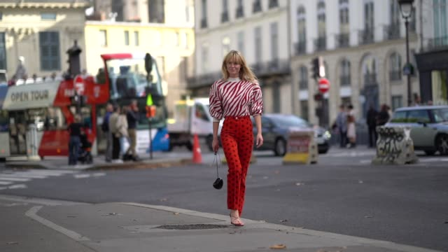 jeanette madsen wears a red and white striped zebra pattern print pullover with shoulder pads red pants with printed features a black bag shaped as a... - zebra print stock videos & royalty-free footage