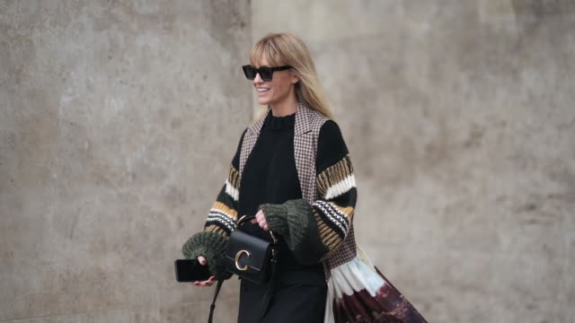 jeanette madsen wears sunglasses a multicolor long jacket with printed picture depicting nature a chloe bag a black dress outside atlein during paris... - chloe designer label stock videos and b-roll footage