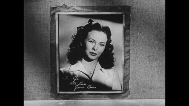 jeanne crain speaks from her photograph to a soldier in the barracks - schlafenszeit stock-videos und b-roll-filmmaterial