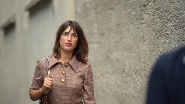jeanne damas wears a brown dress with houndstooth print pattern and golden buttons, purple shoes, outside the prada show during milan fashion week... - checked pattern stock videos & royalty-free footage
