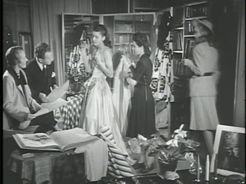 vídeos de stock e filmes b-roll de jeanne lanvin' sign on building, designers female & male for lanvin fashion house examining elegant strapless dress on model, removing cape, checking... - cintura