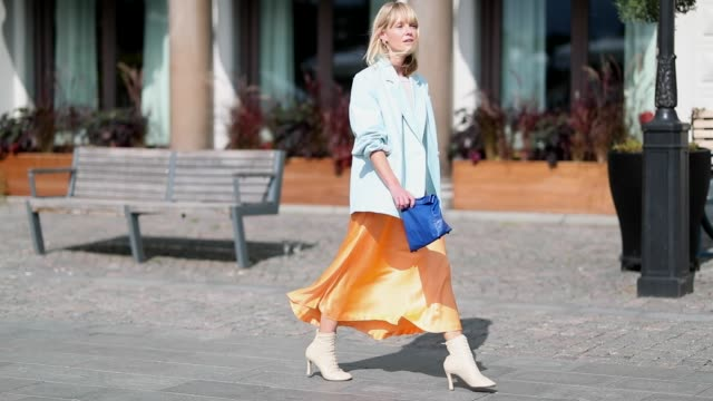 jeannette madsen wearing orange midi skirt ankle boots light blue blazer navy clutch is seen during stockholm runway ss19 on august 28 2018 in... - spring summer collection stock videos & royalty-free footage