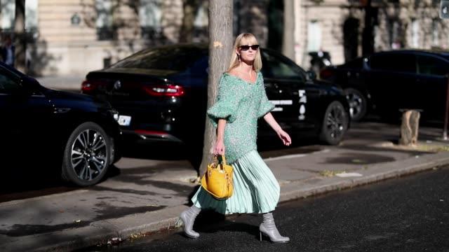 stockvideo's en b-roll-footage met jeannette madsen wearing pastel green knit pleated skirt grey boots with heel yellow bag is seen outside guy laroche during paris fashion week... - hoge hakken
