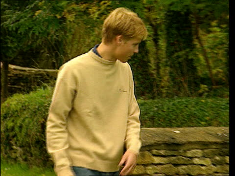 jeans are 'back in'; lib gloucestershire: highgrove: prince william along to stand beside wall wearing jeans tx 12.4.2001/nat - jeans stock videos & royalty-free footage