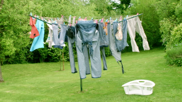 hd: jeans blowing on a washing line - washing line stock videos & royalty-free footage