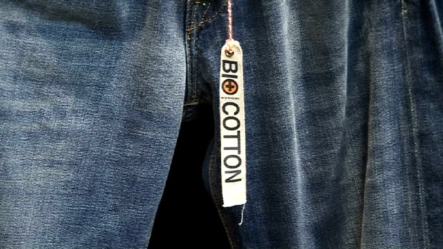 cu of jeans made of bio-cotton. ethical fashion show, paris - fashion show stock videos & royalty-free footage