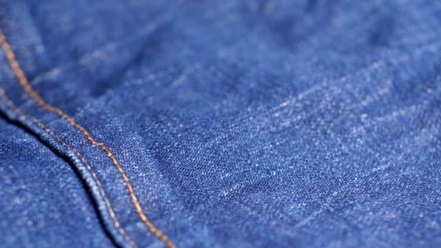 vidéos et rushes de matériel jeans - jeans texture