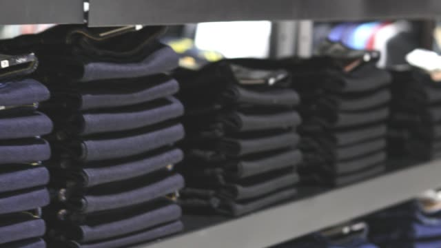 jeans stacked on the shelves. - trousers stock videos & royalty-free footage