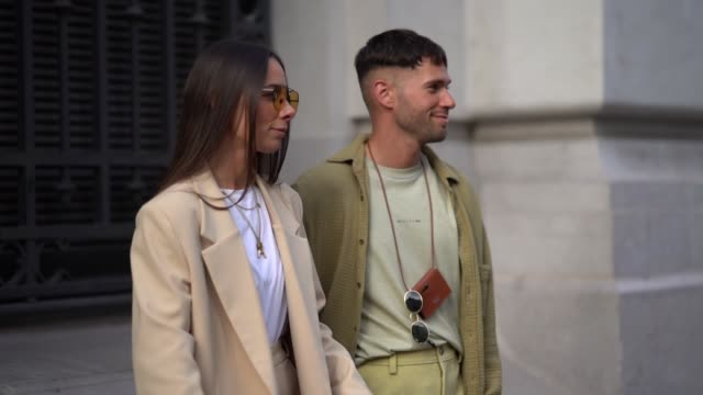 jean-sebastien rocques wears a light khaki alyx top, a small acne studios bag, a camel thick seersucker jacket, light mustard-yellow pant, white... - thick stock videos & royalty-free footage