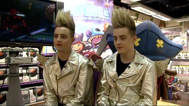 jedward interview at 'disney universe' game launch; jedward interview sot - on their music video for 'wow oh wow' - tara reid is in it / which girls... - television game show stock-videos und b-roll-filmmaterial