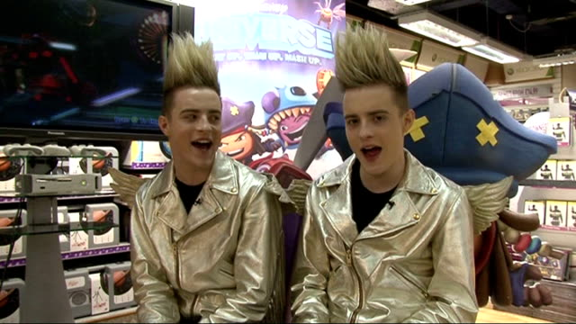 jedward interview at 'disney universe' game launch jedward singing their new song 'wow oh wow' sot - jedward stock videos and b-roll footage