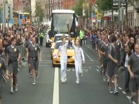 jedward run holding the olympic torch - jedward stock videos and b-roll footage