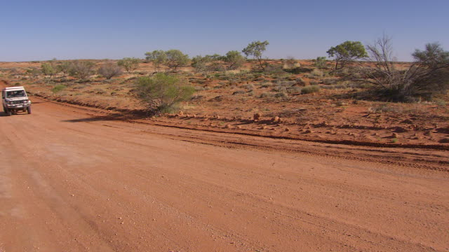 WS Jeep approaching on outback road / Tibooburra, New South Wales, Australia
