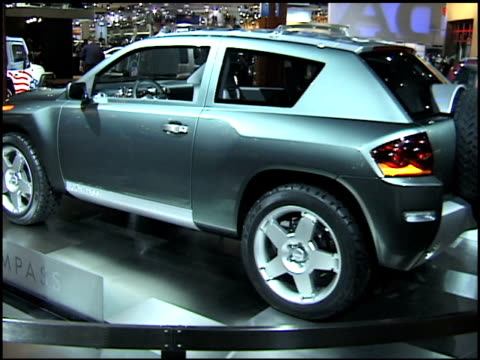 jeep compass revolving on turntable / stopwatch-style dashboard gauges / grated roof; interior 2002 jeep compass concept car montage at cobo hall on... - grated stock videos & royalty-free footage