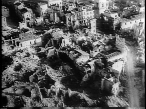 vídeos de stock, filmes e b-roll de jeep entering destroyed city of benevento / church steeple shot through pile of lumber from wrecked building / aerial view of wrecked railroad... - paramount building