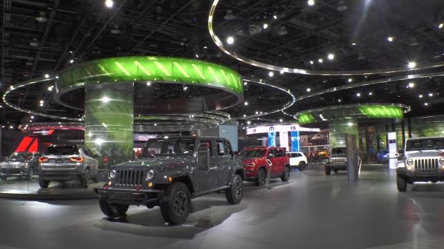 jeep suv on display at the detroit auto show. - tecnologia assistiva video stock e b–roll