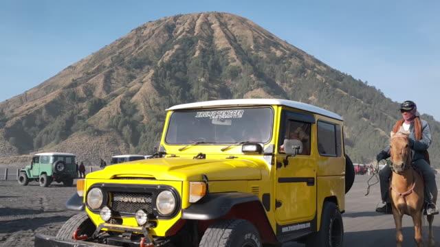 jeep transportation mount of bromo. - bromo tengger semeru national park stock videos & royalty-free footage